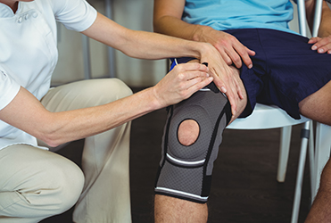 Injured knee wrapped in brace