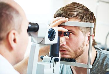 24daf20f09d Man having eyes examined