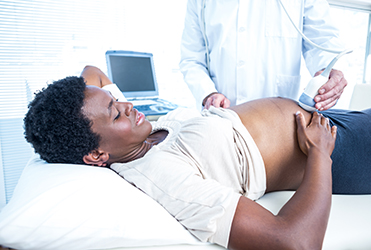 Pregnant woman getting ultrasound